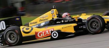 Pro car driver Tony Kanaan. Brazilian Indy Car Driver Tony Kanaan drives the number 10 car in the 2014 race season for Target Chip Ganassi Racing team Royalty Free Stock Image