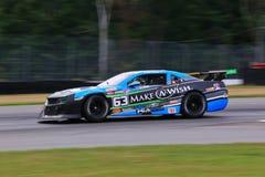 Pro carro de corridas de Chevrolet Camaro no curso Foto de Stock Royalty Free