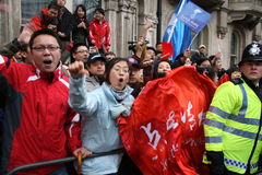 Pro China Supporters at Olympic Torch Relay. A protest in support of China heckling the demonstration in support of a free Tibet; Olympic Torch Parade in London Stock Image