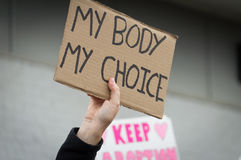 Pro choice Planned Parenthood demonstration holding sign. Person holding a pro-choice sign overhead during a pro choice Planned Parenthood demonstration Royalty Free Stock Photos