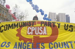 Pro-communist marchers holding banner Stock Photography