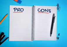 Pro Cons word. On notebook page royalty free stock photography
