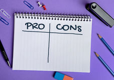 Pro Cons word on notebook. Page Stock Photos
