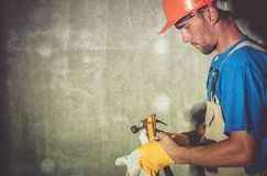 Pro Construction Worker. Preparing For His Job. Construction Worker in Safety Helmet Stock Photography