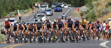 Pro Cycling Peloton charges up a climb panoram  Stock Photography