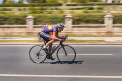 Pro Cyclist on bike race Stock Images