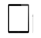 Pro dispositivo portatile del iPad nero di Apple con la matita Fotografie Stock Libere da Diritti