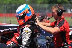 Pro driver getting ready Royalty Free Stock Photo