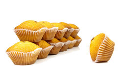 Pro et contra. A muffin in front of cakes Royalty Free Stock Photo