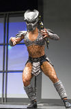 Pro Fitness Star in Scary Costume. Star pro fitness athlete Ariel Khadr, of Miami, Florida, covorts in an unsettling warrior`s costume as part of her stage Stock Photos