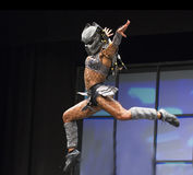 Pro Fitness Star in Scary Costume. Star pro fitness athlete Ariel Khadr, of Miami, Florida, covorts in an unsettling warrior`s costume as part of her stage Royalty Free Stock Photo