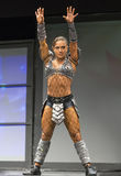 Pro Fitness Star in Warrior Costume. Star pro fitness athlete Ariel Khadr, of Miami, Florida, covorts in an unsettling warrior`s costume as part of her stage Stock Photos