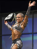 Pro Fitness Star in Warrior Costume. Star pro fitness athlete Ariel Khadr, of Miami, Florida, takes a bow after she demonstrated strength and balance  in a Royalty Free Stock Image