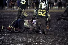 Pro Football game in the mud. Royalty Free Stock Photo