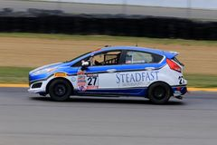 Pro Ford Fiesta race car on the course Stock Image