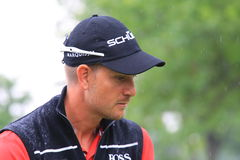 Pro golfer Henrik Stenson. Of Sweeden studies the hole prior to putting at Sports Venue royalty free stock photography