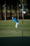 Pro golfer hitting a sand bunker shot Royalty Free Stock Images