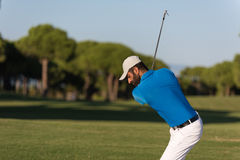Pro golfer hitting a sand bunker shot Stock Photos