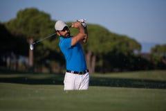 Pro golfer hitting a sand bunker shot Royalty Free Stock Image
