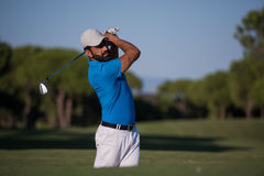 Pro golfer hitting a sand bunker shot. Pro golf player shot ball from sand bunker at course Royalty Free Stock Images