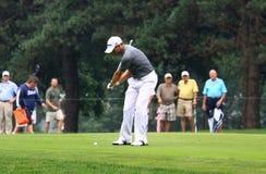Pro Golfer Sergio Garcia. PGA pro Sergio Garcia swings his iron club as the crowd watches on the fairway Stock Photos