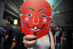 Pro-Government 'Red Shirt' Protest in Bangkok. Masked Red Shirt protesters stage a rally in Bangkok's shopping district to show their support to the government Royalty Free Stock Image