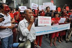 Pro-Government 'Red Shirt' Protest in Bangkok. Masked Red Shirt protesters stage a rally in Bangkok's shopping district to show their support to the government Stock Images