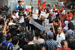Pro-Government 'Red Shirt' Protest in Bangkok. New media cover a Red Shirts rally in Bangkok's shopping district where protesters gathered to show their support Royalty Free Stock Photos