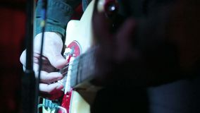 Pro guitarist live performance in concert. Macro detail of a musician when playing a guitar in live concert stock video