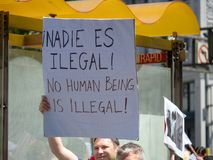 Pro-immigration sign on display by a marcher in a LBGT pride parade. No human being is illegal. SAN FRANCISCO, CA JUNE 23, 2018: Pro-immigration sign on display stock photography