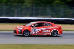Pro-Kia Forte Koup racerbil på kursen Arkivfoto