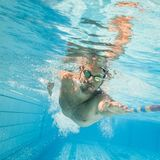 Pro male swimmer in the swimming lane. Male swimmer in the swimming pool.Underwater photo with copy space Stock Image