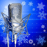 Pro microphone & snowflakes. Cool professional microphone on blue background & snowflakes royalty free illustration