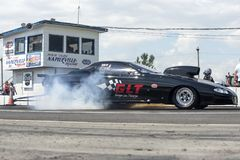 Pro mod drag car making a smoke show on the track at the starting line Stock Photo
