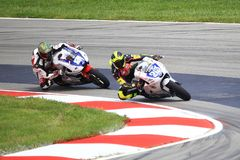 Pro Motorcycle racing, riders leaning into curve stock photos