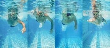 Pro nadador masculino na pista de natação fotos de stock