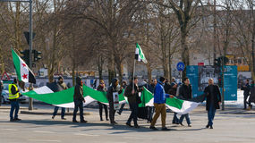 Pro-opposition activists carrying the Syrian flag on demonstration royalty free stock photos