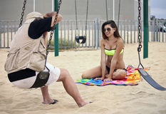 Free Pro Photographer Working With Models On The Beach Stock Photos - 98378273