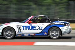 Pro Playboy Mazda MX-5 Cup. Emilee Tominovich races the Mazda MX-5 on the track for TrueCar team at the Pro Playboy Mazda MX-5 Cup, professional motorsports Stock Photo