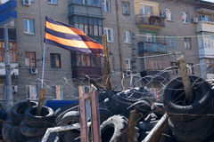 Pro-Russian separatist flag over the barricades. Lugansk, Ukraine. Russia Ukraine conflict , Pro-Russian separatist flag over the barricades near the captured Royalty Free Stock Images