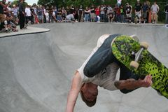Pro Skater: Matt Dove. Skater Matt Dove attends the opening of a new skate park in Kansas City, MO. Pool skating with a crowd behind him Royalty Free Stock Images