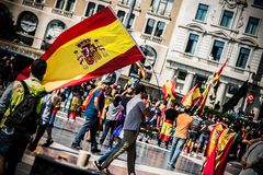 Pro spanish nationalist with a flag in Barcelona, royalty free stock images