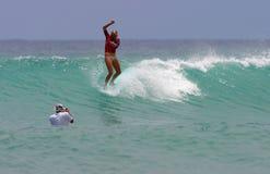 Pro Surfer Bethany Hamilton Surfing at Waikiki. Pro Surfer, Bethany Hamilton, surfing in the the Wahine Classic surf contest in Waikiki, Hawaii.  Bethany lost Stock Image