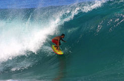 Pro Surfer Braden Dias Surfing at Pipeline Stock Image