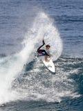 Pro Surfer Kalani Chapman surfing in Hawaii stock photos