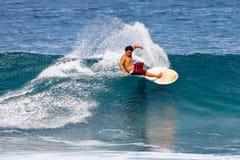 Pro Surfer Keoni Nozaki surfing in Hawaii stock photo