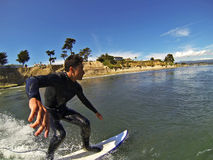 Surfer Noi Kaulukukui Surfing in Santa Cruz, California. Pro Surfer Noi Kaulukukui surfing on a sunny day in Santa Cruz, California, USA royalty free stock photography