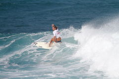 Pro surfer Quincy Davis. Pro surfer woman, winner of the 2010 Corona Extra Pro Surf Championship, held on February 28, in Domes Beach, Rincon, Puerto Rico Royalty Free Stock Image