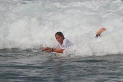 Pro surfer Quincy Davis. Pro surfer woman, winner of the 2010 Corona Extra Pro Surf Championship Royalty Free Stock Photos