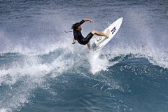 Pro Surfer Reubyn Ash surfing in Hawaii stock photo